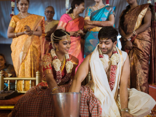 Young couple enjoying Traditional Ring Finding Game in brahmin wedding