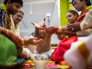 Iyer (Hindu Priest) chants mantra during brahmin wedding ceremony