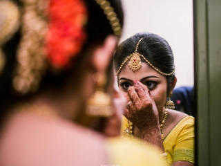 A candid click of bride getting ready for her wedding