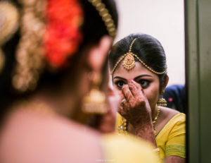 A good candid click of bride getting ready for her wedding
