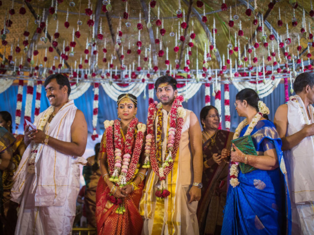 Tamil Brahmin Wedding Couples & their family members on beautifully decorated wedding hall in chennai