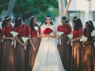 Beautiful Christian bride with her bridesmaids coming to enter church