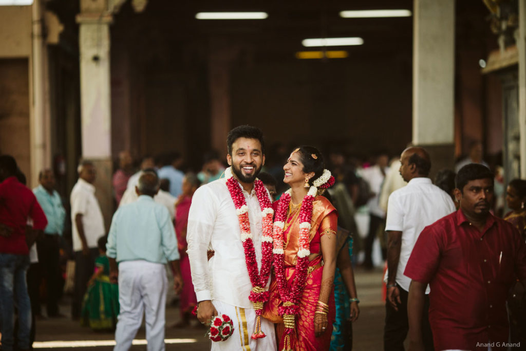 Beautiful wedding couple smiling shots at the temple background