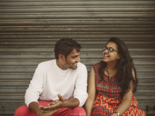 couple's  Casual & cute smile outside the closed shop captured