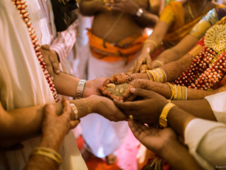 Lovely capture of Kanyadaan Hindu Wedding Ritual in chennai wedding by a brahmin wedding photographer