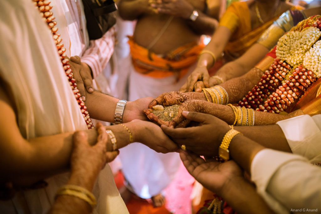 Groom holding bride hands during an Indian brahmin wedding Kanyadaan ritual